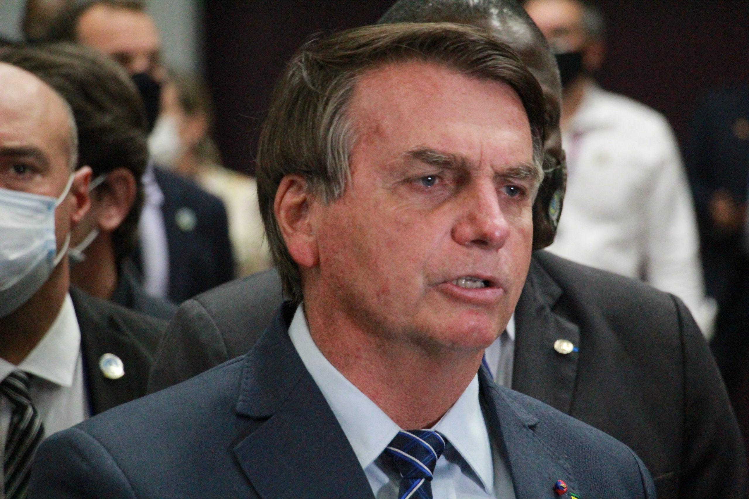 Presidente Jair Bolsonaro dando entrevista sobre o caso do motorista preso na Rússia