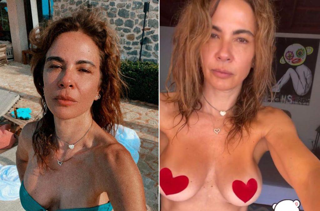 Luciana Gimenez de biquini e com os seios de fora em viagem a Ibiza