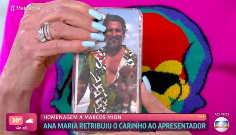 Ana Maria Braga usa capinha com o rosto de Marcos Mion