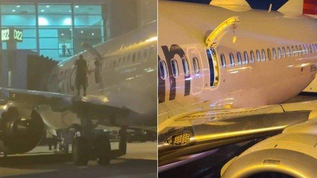 Passageiro sobe em asa de avião em Miami